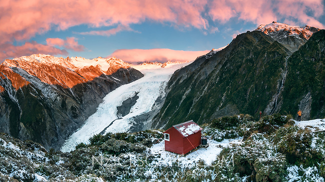 Pink sunset over Franz Josef Glacier viewed from Castle Rock Hut, Westland Tai Poutini National Park, West Coast, UNESCO World Heritage Area, New Zealand, NZ