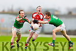 Daniel O'Sullivan Rathmore gets away his pass as Kilcummin duo Sean Brosnan and Chris O'Leary tackle him during the East Kerry semi final in Fitzgerald Stadium on Saturday