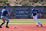 Former Wildcats Andrew Garcia, left, and Kevin Taylor turn a double play in the alumni game at Western Nevada College in Carson City, Nev., on Saturday, Sept. 7, 2013.  <br /> Photo by Cathleen Allison