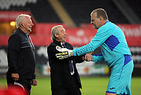 Brian Flynn of Swansea (C) greets Roger Freestone (R) during the Alan Tate Testimonial Match, Swansea City Legends v Manchester United Legends at the Liberty Stadium, Swansea, Wales, UK