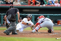 Harrisburg Senators catcher Sandy Leon #40 tags out Luis Castillo attempting to score as umpire Nick Mahrley looks on during a game against the Erie Seawolves on July 2, 2013 at Jerry Uht Park in Erie, Pennsylvania.  Erie defeated Harrisburg 2-1.  (Mike Janes/Four Seam Images)