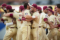 Cal Raleigh (left) of the Florida State Seminoles gets a hug from teammate Bryan Bussey (53) following their win over the North Carolina Tar Heels during the 2017 ACC Baseball Championship Game at Louisville Slugger Field on May 28, 2017 in Louisville, Kentucky.  The Seminoles defeated the Tar Heels 7-3.  (Brian Westerholt/Four Seam Images)
