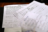 WASHINGTON, DC - SEPTEMBER 27:  Notes left behind by a Democratic Senator are left on the dias at the conclusion of Supreme Court nominee Judge Brett Kavanaugh's confirmation hearing before the Senate Judiciary Committee in the Dirksen Senate Office Building on Capitol Hill September 27, 2018 in Washington, DC. Kavanaugh was called back to testify about claims by Christine Blasey Ford, who has accused him of sexually assaulting her during a party in 1982 when they were high school students in suburban Maryland.  (Photo by Win McNamee/Getty Images)