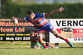 Sione Tu'ipulotu stretches out and scores despite Akariva Niubalavu's attemped tackle. Counties Manukau Premier Club Rugby game between Waiuku and Ardmore Marist, played at Waiuku on Saturday June 4th 2016. Ardmore Marist won 46 - 3 after leading 39 - 3 at Halftime. Photo by Richard Spranger.