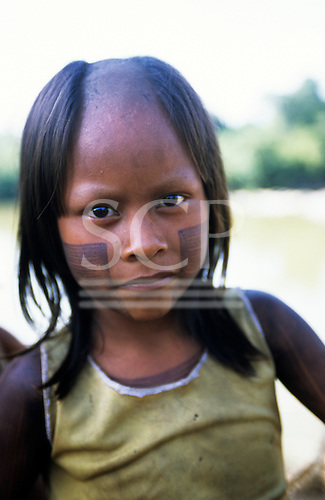 Bacaja village, Amazon, Brazil. Girl with face paint, shaved head; Xicrin tribe.