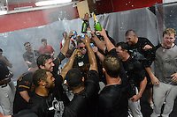 Rochester Red Wings celebrate in the locker room after defeating the Scranton Wilkes Barre RailRiders on September 2, 2013 at Frontier Field in Rochester, New York to clinch the International League Wild Card Playoff spot.  (Mike Janes/Four Seam Images)