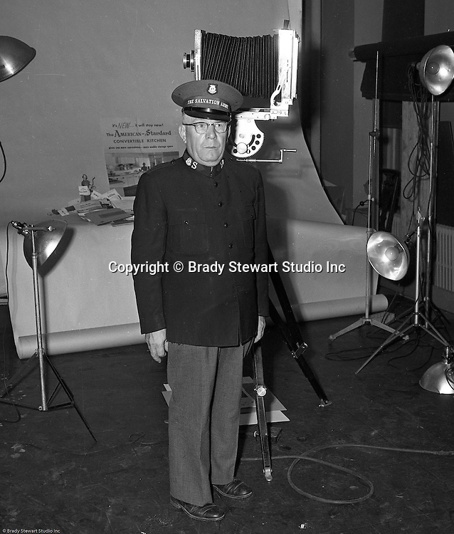 Pittsburgh PA:  Major Henry Dries from the Salvation Army at Brady Stewart Studio of a PR shot - 1955.  Major Dries directed Public Relations and Disaster Services for the Salvation Army in Pittsburgh.  In the 1960's he was promoted to Brigadier due to his exceptional job performance and standing in the community.  He was a frequent visitor to the studio due to friendship with Brady Stewart Sr.