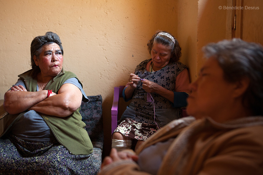 Residents of Casa Xochiquetzal attend a weekly meeting at the shelter in Mexico City, Mexico on October 15, 2012. Community life and participation is promoted among residents by means of easy-to-follow rules. Casa Xochiquetzal is a shelter for elderly sex workers in Mexico City. It gives the women refuge, food, health services, a space to learn about their human rights and courses to help them rediscover their self-confidence and deal with traumatic aspects of their lives. Casa Xochiquetzal provides a space to age with dignity for a group of vulnerable women who are often invisible to society at large. It is the only such shelter existing in Latin America. Photo by Bénédicte Desrus
