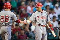Philadelphia Phillies OF Raul Ibanez greets Chase Utley (26) against the Houston Astros on Turn Back the Clock Nite. Game played on Saturday April 10th, 2010 at Minute Maid Park in Houston, Texas.  (Photo by Andrew Woolley / Four Seam Images)