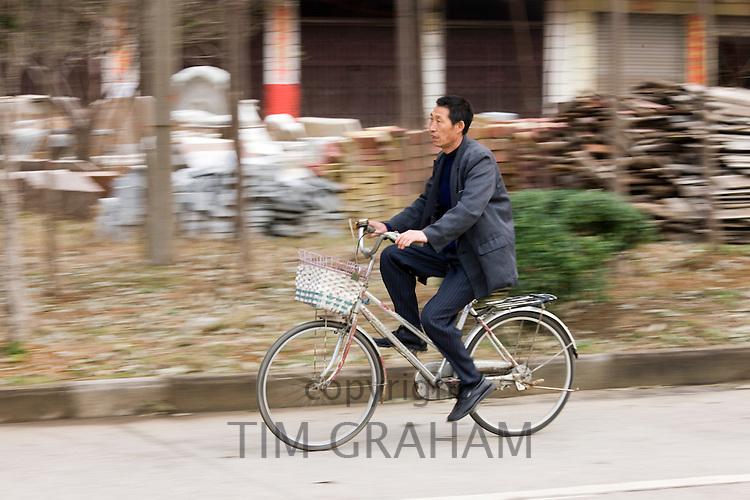 Man on bicycle near Guilin, China