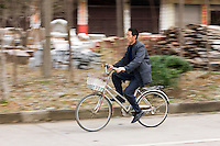Man on bicycle near Guilin, China