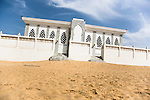 "The Seydina Limamou Laye Mausoleum sits on the coast of Senegal in the fishing village of Yoff.  Seydina Limamou Laye (1843-1909) was the founder of the Layène (meaning ""partisans of God"") brotherhood."