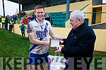 Paddy Fogarty presenting the Damian Fogarty Memorial Man of the Match award to St Mary's Darragh O'Sullivan at the South Kerry Final in Portmagee on Sunday.
