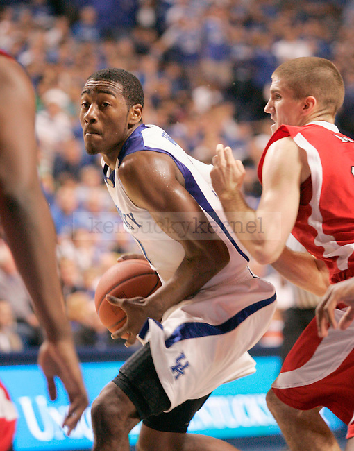 Freshman guard John Wall looks to make a pass during the first half of the game against Miami at Rupp Arena Monday night. .Photo by Zach Brake | Staff