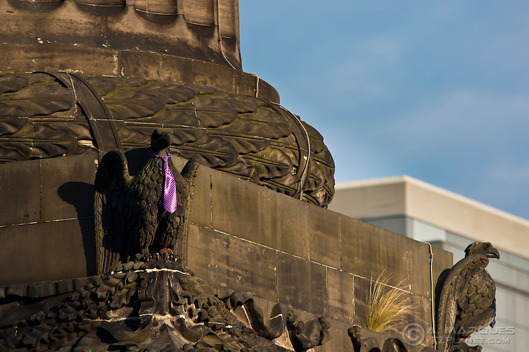 Purple tie around an eagle's neck at the base of the Melville Monument, St. Andrew's Square, Edinburgh. The demostration is part of the Occupy Edinburgh movement.