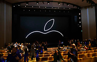 People file into the Steve Jobs Theater before an event to announce new Apple products Wednesday, Sept. 12, 2018, in Cupertino, Calif. (AP Photo/Marcio Jose Sanchez)