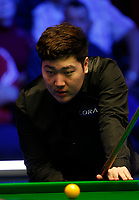 1st March 2020; Waterfront, Southport, Merseyside, England; World Snooker Championship, Coral Players Championship; Yan Bingtao (CHN) lines up his shot during the evening session final against Judd Trump (ENG)
