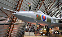 BNPS.co.uk (01202 558833)<br /> Pic: RAFMuseumCosford/BNPS<br /> <br /> Cleaning the nose cone of the AVRO Vulcan.<br /> <br /> Prop Dusting - The annual spring clean of the stunning aircraft hall at the RAF Museum at Cosford has begun.<br /> <br /> A crack team of aerial cleaners are abseiling over the historic aircraft, some of which are suspended up to a hundred feet above the museum floor, all week to clean away any residue dust and check over the suspension cables.