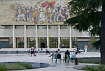 ALBANIA, Tirana, Palace of Culture  with large communist propaganda wall painting, built 1963 during Enver Hoxha communist rule / ALBANIEN, Tirana, Kulturpalast mit Wandgemaelde, gebaut 1963 waehrend der kommunistischen Herrschaft von Enver Hoxha, Rabatte mit Heilkraeuter Pflanzung