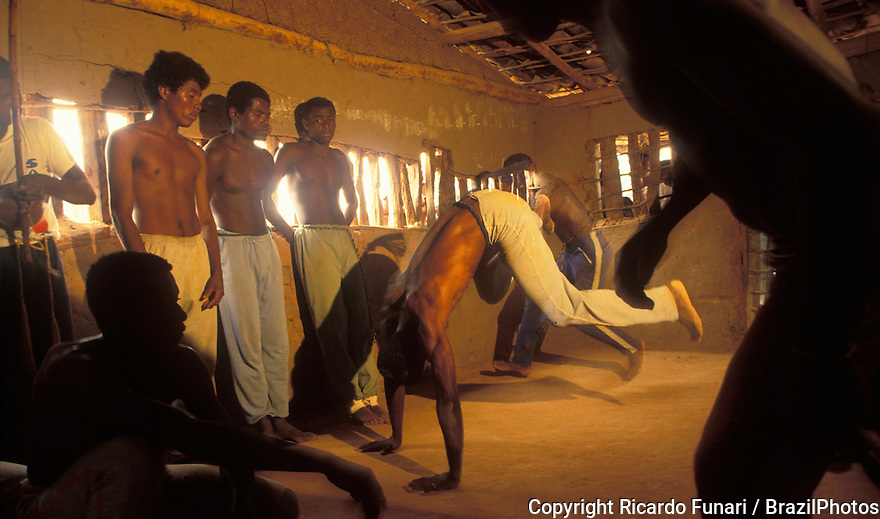 "Capoeira, a Brazilian martial art that combines elements of dance, acrobatics and music, and is usually referred to as a game - known for quick and complex moves, using mainly power, speed, and leverage for a wide variety of kicks, spins, and highly mobile techniques - On 26 November 2014 capoeira was granted a special protected status as ""intangible cultural heritage"" by UNESCO. Rio das Ras Quilombo in Bahia State, northeastern Brazil. A quilombo is a Brazilian hinterland settlement founded by people of African origin. Most of the inhabitants of quilombos were escaped former slaves and, in some cases, a minority of marginalised non-slave Brazilians that faced oppression during colonization."