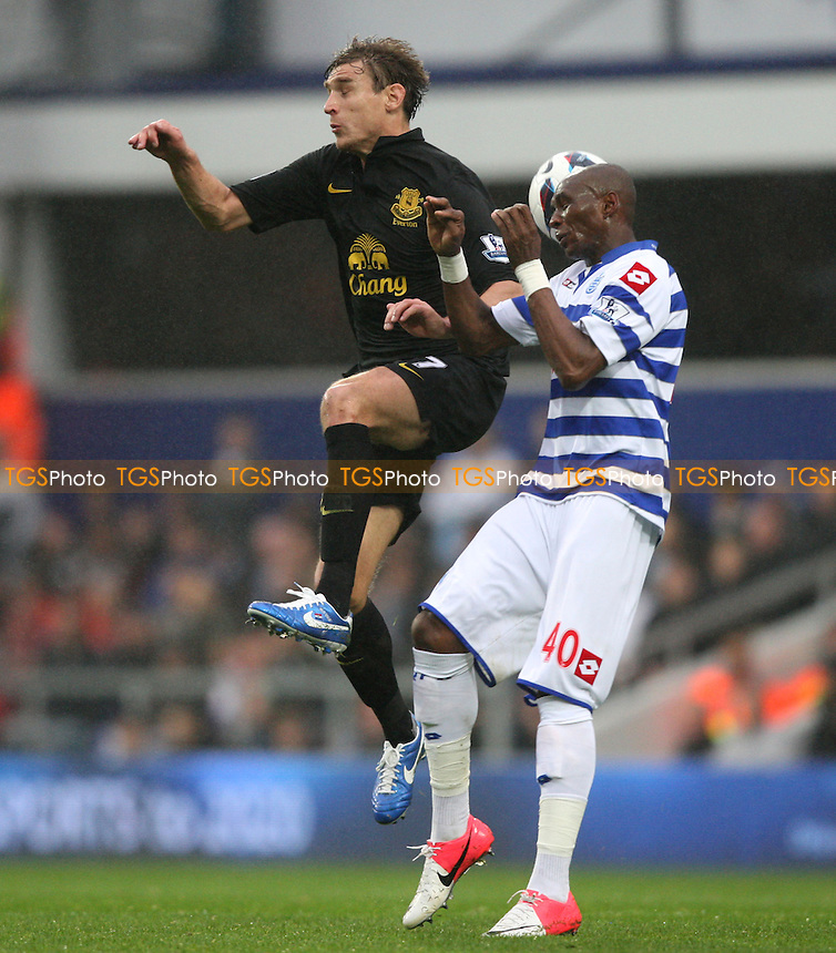 Nikica Jelavic of Everton and Stephane Mbia of QPR - Queens Park Rangers vs Everton, Barclays Premier League at Loftus Road - 21/10/12 - MANDATORY CREDIT: Rob Newell/TGSPHOTO - Self billing applies where appropriate - 0845 094 6026 - contact@tgsphoto.co.uk - NO UNPAID USE.