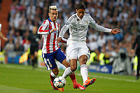 Real Madrid's French defense Raphael Varane and Atletico Madrid´s French forward Antoine Griezmann