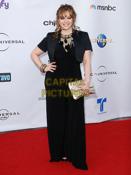 JENNI RIVERA . arriving at the The Cable Show 2010 To Feature An Evening With NBC Universal held at  Universal Studios Hollywood in Universal City, California, USA, .May 12th, 2010..full length black dress  hand on hip long maxi gold clutch bag bracelet necklace .CAP/ROT/AMB.©Adriana M. Barraza /Roth Stock/Capital Pictures
