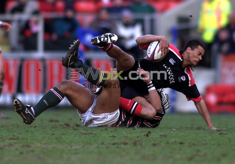 Pix, Shaun Flannery\SWPIX. Rugby Union Zurich Premiership..Leicester Tigers v Saracens, 24/02/2001..COPYRIGHT PICTURE>>SIMON WILKINSON>>01943 - 436649>>..Leicester's Freddie Tuilagi tackles Saracen's Richard Haughton.
