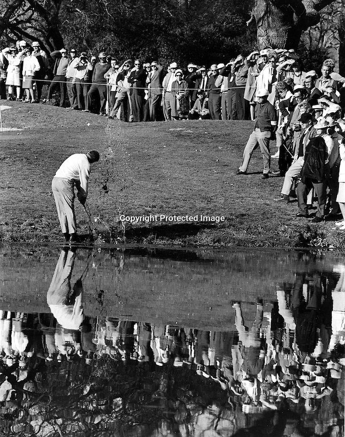Billy Casper hits out of the water at Silverado Country Club in Napa, California during the P.G.A. Kaiser Open. (photo/Ron Riesterer)