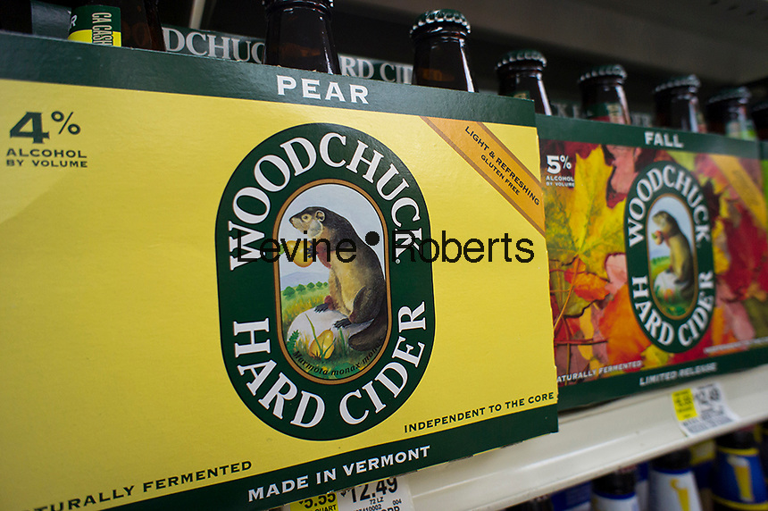Six-packs of Woodchuck hard Cider are seen on a grocery store shelf in New York on Wednesday, October 24, 2012. C&C Group, the makers of Magnars cider and other ciders and beer, has purchased the Middlebury based Vermont Hard Cider Company, the makers of Woddchuck Cider.  (© Richard B. Levine)