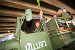 Apr. 19 2010 - BANGKOK, THAILAND: Thai soldiers wave to the crowd as they drive through the Silom financial district Monday. Hundreds of Thai soldiers, including reservists and front line units, and riot police moved into the Silom financial district Monday, not far from the red-shirts' main protest rally site, in Ratchaprasong. The heavy show of force is to prevent the Red Shirts from entering the Silom area. Many of soldiers were greeted as heros by workers in the area, who oppose the Red Shirts.   Photo by Jack Kurtz