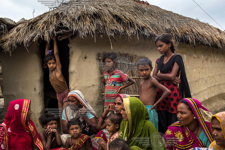 Women and their children gather for a weekly meeting to discuss health related issues in Bhelaiya village.