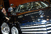 Chinese visitors look at a Mercedes-Benz car during the 2006 International Automotive Exhibition in Beijing China..25 Nov 2006