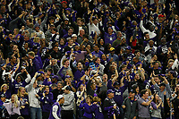 Northwestern Wildcats fans celebrate a 77-yard touchdown by Northwestern Wildcats running back John Moten IV (20) during the first quarter of the Big Ten Championship against the Ohio State Buckeyes at Lucas Oil Stadium in Indianapolis on Dec. 1, 2018. [Adam Cairns/Dispatch]