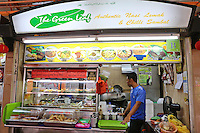The Green Leaf Stall at the Maxwell Food Centre in Singapore.  Located in the heart of Chinatown, Maxwell Road Hawker Centre has over 100 stalls, providing one of the biggest varieties of local food in Singapore