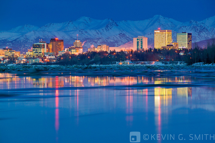 The anchorage city skyline and Knik arm at twilight, city lights reflected in the water, twilight, winter, Anchorage, Akaska USA.
