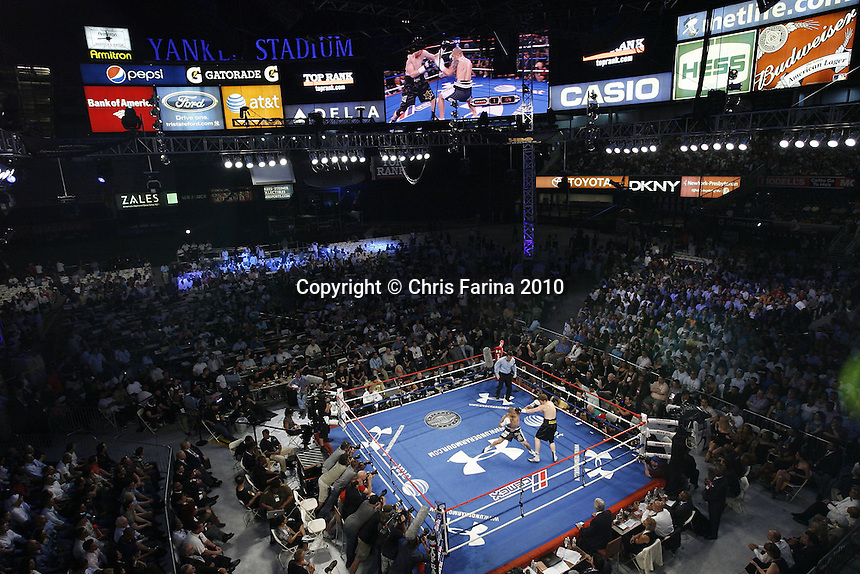 6/5/10, New York,N.Y.  --- This exclusive remote shot from above the ring shows the action in round one  during the Cotto-Foreman fight at Yankee Stadium.   ---   Miguel Cotto(L),Caguas, Puerto Rico dethrones previously unbeaten WBA World Super Welterweight champion Yuri Foreman(R),Brooklyn,N.Y., to win the WBA World Super Welterweight title by stopping Foreman in the 9th round Saturday night at Yankee Stadium. --- Photo Credit : Chris Farina - Top Rank  (no other credit allowed)  copyright 2010