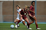 03 November 2013: Boston College's Jana Jeffrey (12) and North Carolina's Kealia Ohai (7). The University of North Carolina Tar Heels hosted the Boston College Eagles at Fetzer Field in Chapel Hill, NC in a 2013 NCAA Division I Women's Soccer match and the quarterfinals of the Atlantic Coast Conference tournament. North Carolina won the game 1-0.