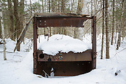 Abandoned vehicle in the Tunnel Brook drainage of Benton, New Hampshire during the winter months. During the 1900s there was a road, connecting Benton and Warren, through Tunnel Brook Notch. And it is believed the road was closed in 1927 because of landslides. This is possibly a 1920s International truck.