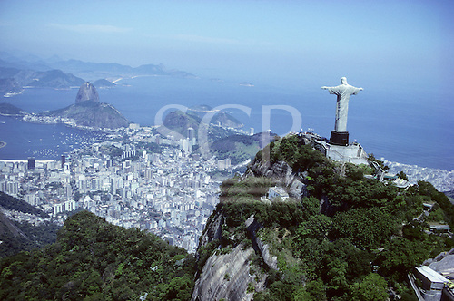 Rio de Janeiro, Brazil. Christ statue, aerial shot with the Sugarloaf and Guanabara Bay behind. Corcovado mountain.