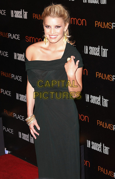JESSICA SIMPSON.Palms Place Hotel and Spa Grand Opening, Las Vegas, Nevada, USA, .31 May 2008..half length gold earrings black dress  ponytail off one the shoulder bracelets ring.CAP/ADM/MJT.©MJT/Admedia/Capital Pictures