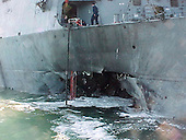ADEN, Yemen (October 12, 2000) -- Port side view showing the damage sustained by the Arleigh Burke class guided missile destroyer USS Cole (DDG 67) after a suspected terrorist bomb exploded during a refueling operation in the port of Aden.  USS Cole is on a regular scheduled six-month deployment. <br /> Credit: U.S. Navy / CNP