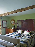 The focal point of this guest bedroom is the headboard which has been adapted from a Chinese screen