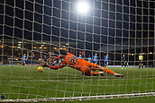 6th February 2019, Dens Park, Dundee, Scotland; Ladbrokes Premiership football, Dundee versus Kilmarnock; Daniel Bachmann of Kilmarnock saves a penalty from Kenny Miller of Dundee in the 94th minute