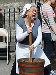 Betty Quinn from Millmount Museum enjoys churning butter at the open day at Millmount Square. Photo: Colin Bell/pressphotos.ie