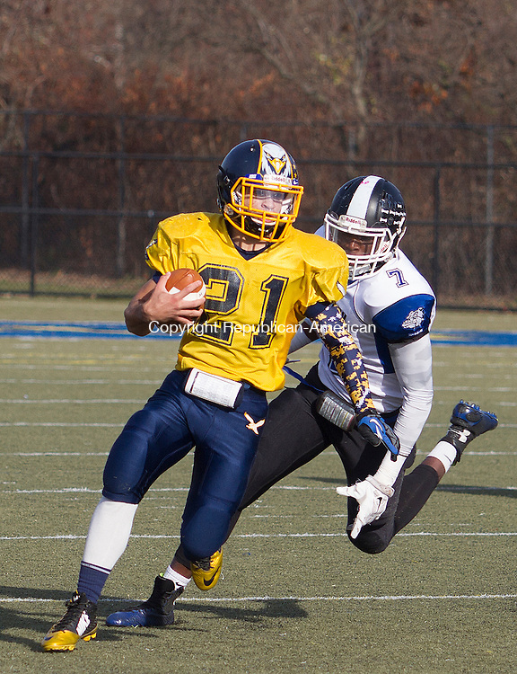 WATERURY, CT - 26 NOVEMBER 2015 -112615JW01.jpg -- Kennedy #21 Bryan Garcis-Medina is chased by Crosby #7 Alvin Lopes during the Thanksgiving Day 2015 Brass Division and City Championship game at Ray Snyder Sr. Field Thursday morning. Crosby won 18-15.  Jonathan Wilcox Republican-American