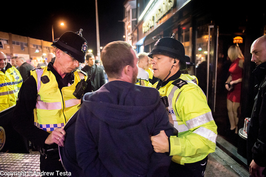 UK.Cleethorpes . 20th October 2013<br /> police arrests man outside a cleethorpes bar.<br /> &copy;Andrew Testa for the Sunday Times Magazine
