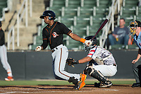 Gerrion Grim (18) of the Delmarva Shorebirds follows through on his swing against the Kannapolis Intimidators at Kannapolis Intimidators Stadium on June 30, 2017 in Kannapolis, North Carolina.  The Shorebirds defeated the Intimidators 6-4.  (Brian Westerholt/Four Seam Images)