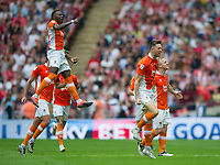 Blackpool players celebrating after second goal during the Sky Bet League 2 PLAY OFF FINAL match between Exeter City and Blackpool at Wembley Stadium, London, England on 28 May 2017. Photo by Andrew Aleksiejczuk.