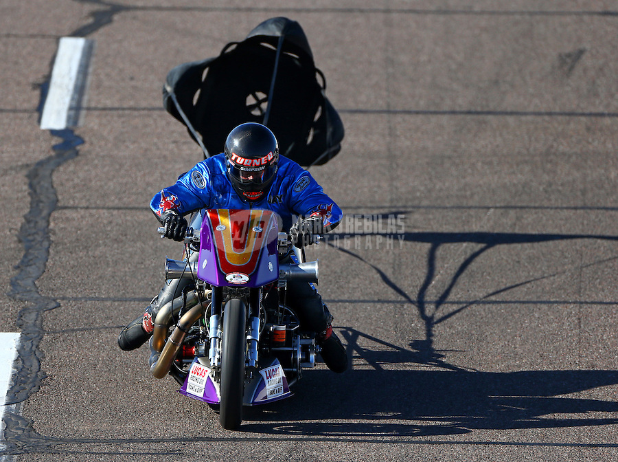 Feb 27, 2016; Chandler, AZ, USA; NHRA top fuel harley motorcycle rider Jay Turner slows with the help of a parachute during qualifying for the Carquest Nationals at Wild Horse Pass Motorsports Park. Mandatory Credit: Mark J. Rebilas-USA TODAY Sports